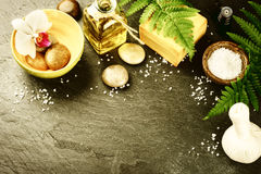 Spa setting with soap bar, herbal massage ball and essential oil Stock Images
