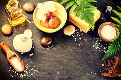 Spa setting with soap bar, herbal massage ball and essential oil Stock Photography