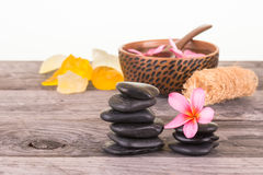 Spa setting with soaps, stones and loofah close-up Stock Photography