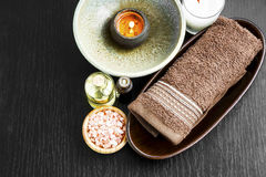 Spa setting with towel, candle, salt and body-oil Stock Photo