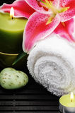 Spa setting with towel and candles Stock Image