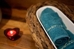 SPA setting – towel and heart candle Royalty Free Stock Photos