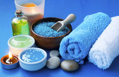Spa setting with towels,face mask, bath salt and oil and candle Royalty Free Stock Photography