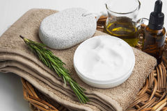 Spa setting with towels and organic skincare products Stock Photos