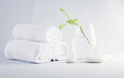 Spa setting with towels. Still life spa setting with towels and young orchid flower in glass stock photos
