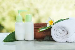 Spa setting with tropical flowers, bowl of water stock images