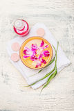Spa setting with water bowl , pink orchid flowers, lotion bottle and white towel, top view. Royalty Free Stock Photography