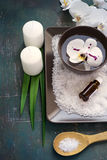 SPA setting with white orchid blossoms and sea salt and candles. Stock Image