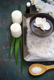 SPA setting with white orchid blossoms and sea salt and candles. Stock Photography
