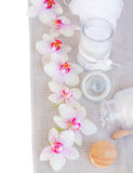 Spa settings with pink orchideas and aroma candle Royalty Free Stock Image