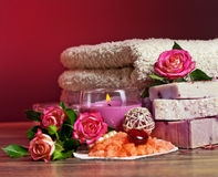 Spa Settings with roses and salt in bowl , towel. Candle,soap on Royalty Free Stock Images