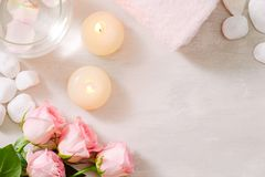Spa settings with roses. Spa theme with candles and flowers on t royalty free stock image