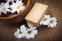 Spa soap with bowl of water and flowers Royalty Free Stock Photo