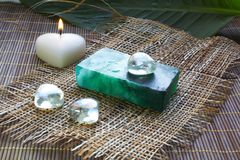 Spa soap and candle on bamboo mat. Spa green soap and candle on bamboo mat Royalty Free Stock Photos