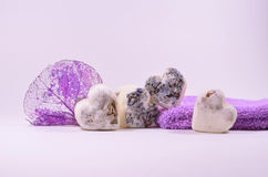 Spa soap natural lavender and lemongrass hearts. Spa natural lavender and cymbopogon soap hearts with violet towel Stock Image