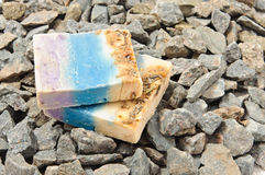 Spa soap on rocks Stock Images
