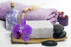 Spa soap with towel and orchids Stock Images