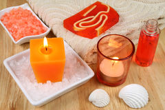 Spa soothe. Orange Spa resort therapy composition - candles, shells and salt crystals Royalty Free Stock Photo