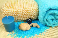 Spa soothe in blue color. Wellness therapy with sea salt, shell and candle Stock Image