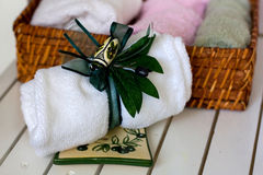 Spa still life. Basket and white towels Royalty Free Stock Images