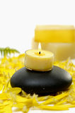 Spa still life. Bottle of massage oil and handmade Soap on yellow flower peals Royalty Free Stock Image