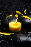 Spa still life. Spa concept- yellow flower petals with yellow candle Stock Photography