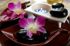 Spa still life. Aromatic candle, stones and orchid Stock Photography