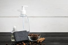 Spa still life. Aroma oils, stones, soap, shampoo and coffee beans on wooden background. Various bath accessories. Items for the spa. Copy space Royalty Free Stock Photo