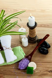 SPA still life with aromatic burning candles, stones, towel and lavender bath salt Royalty Free Stock Photo