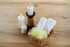 SPA still life with aromatic burning candles, stones, towel and lavender bath salt. On wood Royalty Free Stock Photo