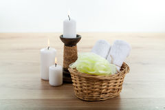 SPA still life with aromatic burning candles, stones, towel and lavender bath salt. On wood Royalty Free Stock Photography