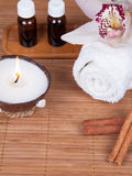 Spa still life with aromatic candle, orchid flower, towel and ar Royalty Free Stock Images