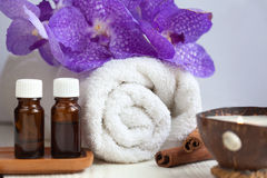 Spa still life with aromatic candle, orchid flower, towel, aroma Stock Images