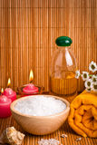 Spa still life with aromatic candles, flower and towel Stock Photos