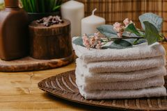 Spa still life with aromatic candles, flower and towel. - Imag royalty free stock photos