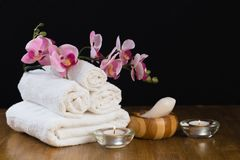 Spa still life with aromatic candles, flower and towel. - Image
