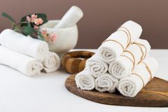 Spa still life with aromatic candles, flower and towel. - Image stock image