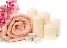 Spa still life with aromatic candles,orchid flower and towel. - Image royalty free stock image