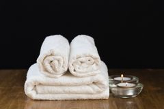 Spa still life with aromatic candles and towel. - Image royalty free stock image