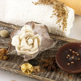 Spa setting with towels and candle Royalty Free Stock Image