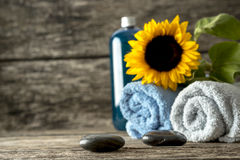 Spa still life - beautiful blooming sunflower on top of two roll Royalty Free Stock Images
