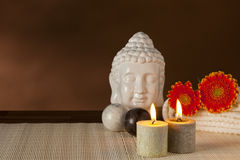 Spa still-life. With buddha head, Qigong balls, candles and flowers Stock Photo