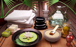Spa still life with burning candles, clay mask and flower. Royalty Free Stock Image