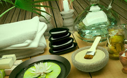 Spa still life with burning candles, clay mask and flower. Spa still life with burning candles, clay mask and flower of an water Lily on wooden background Stock Images
