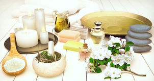 Spa still life with burning candles and flowers of an apple-tree Stock Image