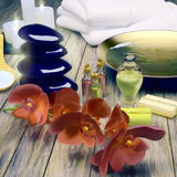 Spa still life with burning candles and flowers. Royalty Free Stock Images