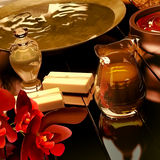 Spa still life with burning candles and flowers. Royalty Free Stock Photo
