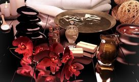 Spa still life with burning candles and flowers of an orchid on Stock Images