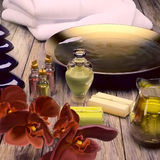 Spa still life with burning candles and flowers of an orchid. Royalty Free Stock Image