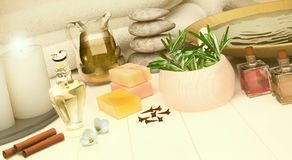 Spa still life with burning candles on golden background. Royalty Free Stock Images